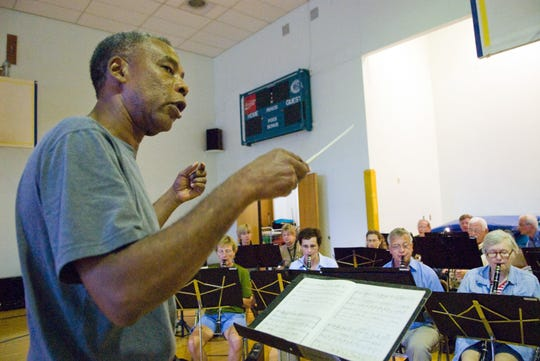 Retired Kodak employee Ron Bowks of Henrietta, conducts the Kodak Concert Band during a 2009 practice at Hope Hall in Gates. Bowks had been with the band since its inception.