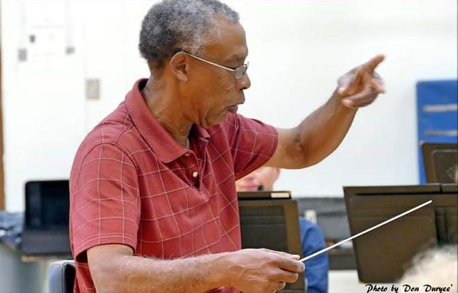 Ron Bowks  conducts.