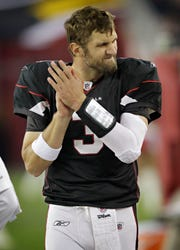 Arizona Cardinals quarterback Derek Anderson grimaces during a game against the San Francisco 49ers in 2010.