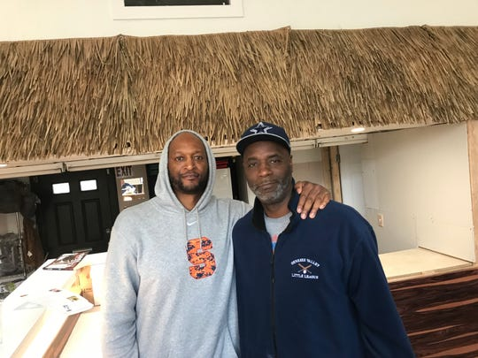 Basketball star John Wallace and Reggie Smith at B+Healthy on Genesee St.
