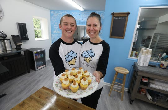 Racheal Roberts, with husband Greg Roberts, in their new Secret Ingredient Cupcakery.
