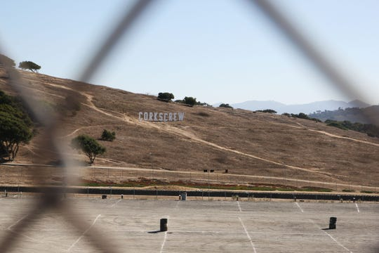 The Corkscrew is the most infamous portion of the Laguna Seca track. It is marked with a hillside sign.