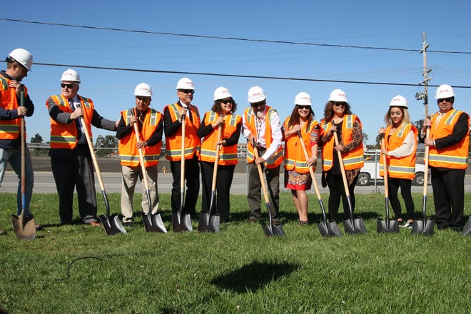 Staff, board members and students prepare to break ground on Mt. Toro High's multipurpose center.