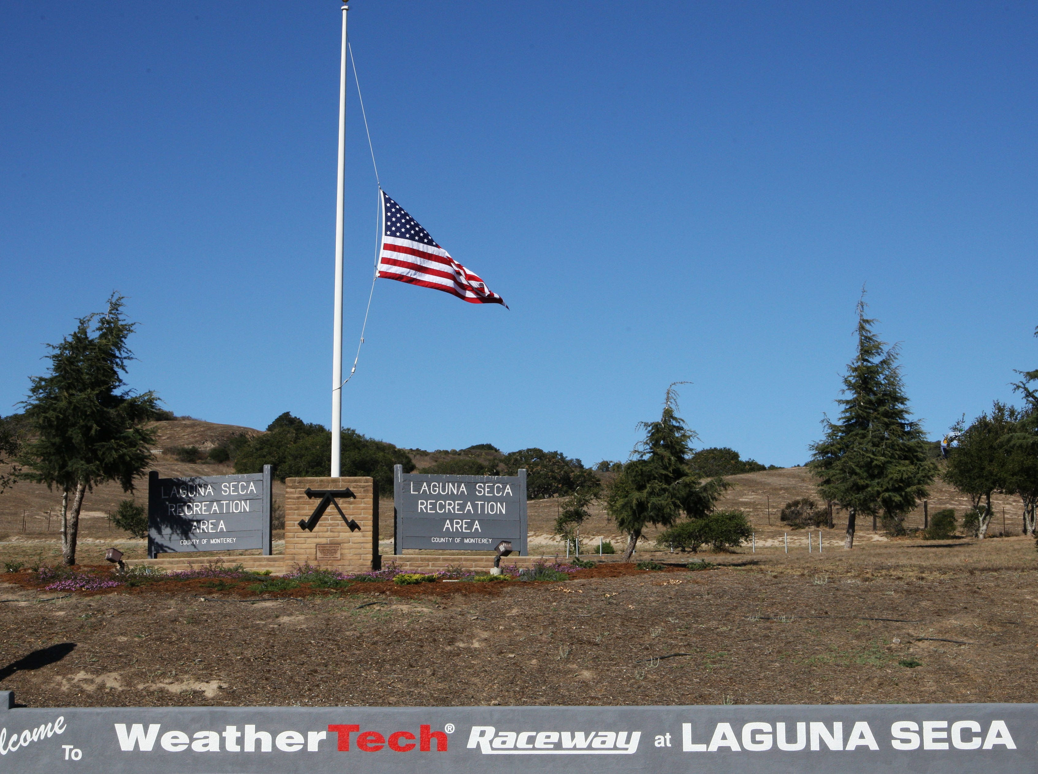 Laguna Seca flies the American flag at half mast after the death of Richard Reins on the track.