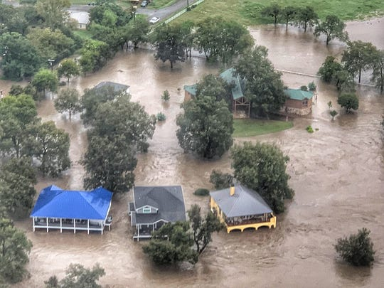 Floodwater from the Llano River engulfs homes Oct. 16, 2018, in Kingsland.