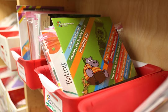 Small buckets of reading materials for all grade levels sit on shelves inside the book room Oct. 3, 2018, at Lamar Elementary.