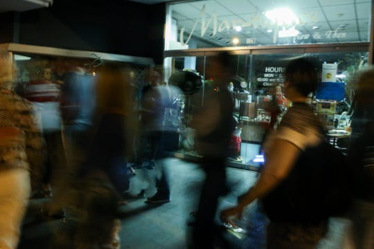 Participants in Be Theatre's Ghost Walk pass by Mar-tiques on Chadbourne Street in downtown San Angelo in 2016.