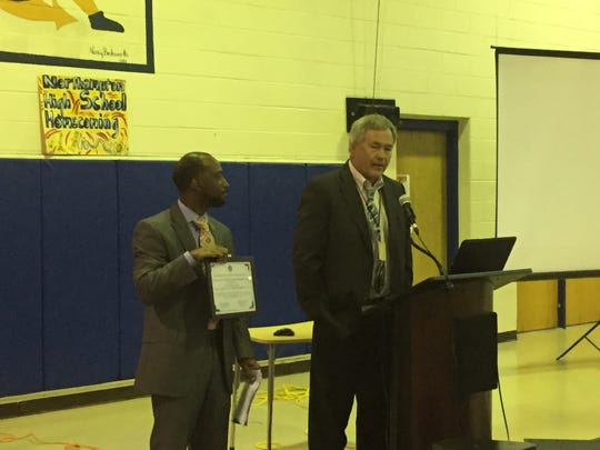 Wayne Bell, left, accepts a Community School Partnership Award from Northampton School Superintendent Eddie Lawrence during the 2nd annual State of the Schools forum in Eastville, Virginia on Tuesday, Oct. 16, 2018.