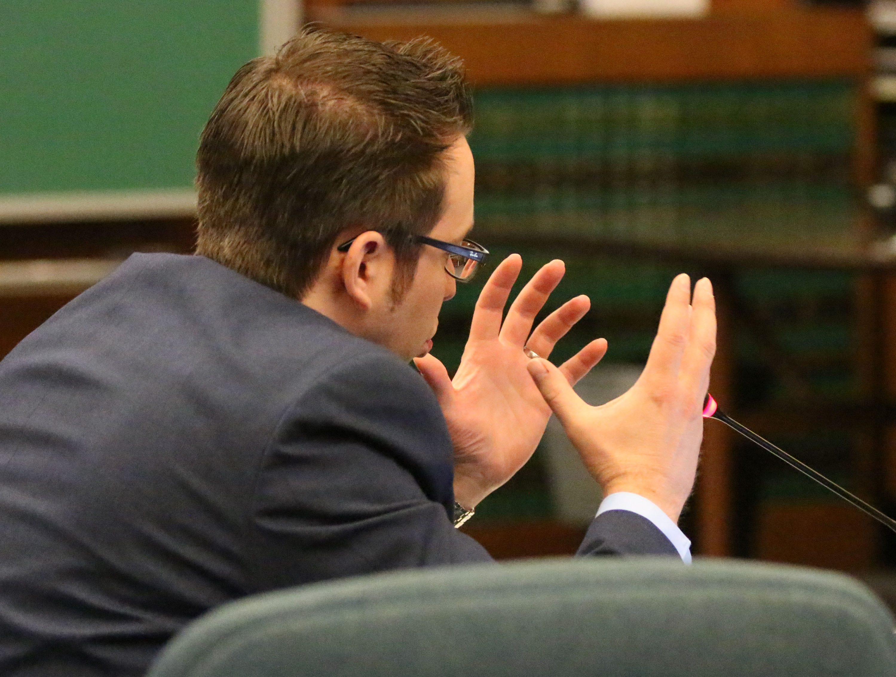 Sheboygan County District Attorney Joel Urmanski gestures while speaking about Breanna Mikula about her involvement in the Kinship Companions kennel case in Sheboygan County Circuit Court Branch 1, Tuesday, October 16, 2018, in Sheboygan, Wis