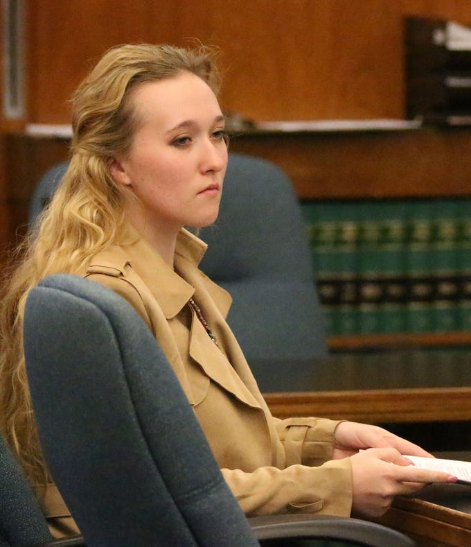 Breanna Mikula sits in Sheboygan County Circuit Court Branch 1, Tuesday, October 16, 2018, in Sheboygan, Wis.  Mikula pled no contest to charges in the Kinship Companions kennel case.