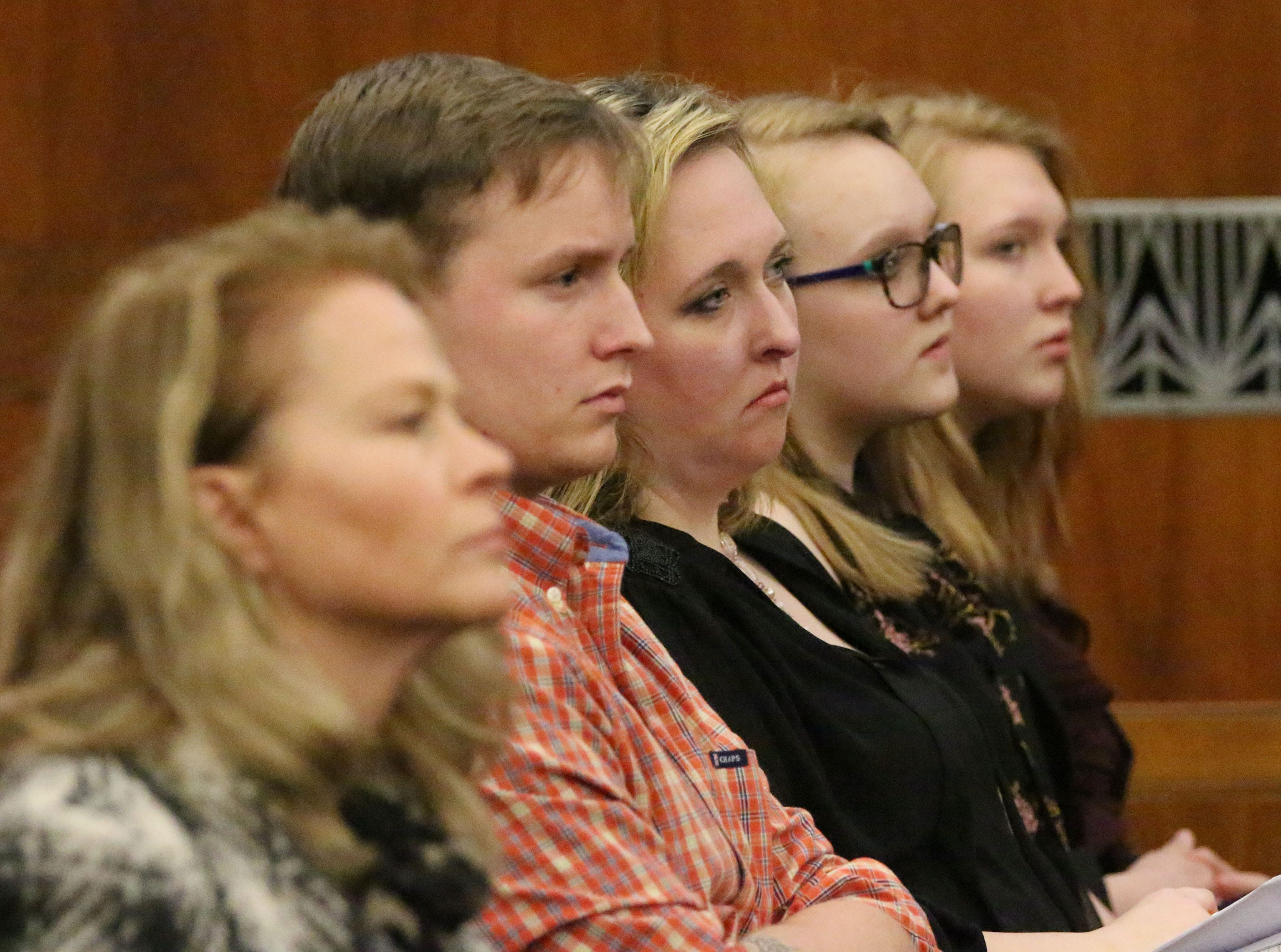 Christy Rose Tuchel, second from left, sits in Sheboygan County Circuit Court Branch 1, Tuesday, October 16, 2018, in Sheboygan, Wis. Tuchel, who was earlier convicted in the Kinship Companions kennel case, sat in court to hear the sentence being imposed on her daughter Breanna Mikula in the kennel case.