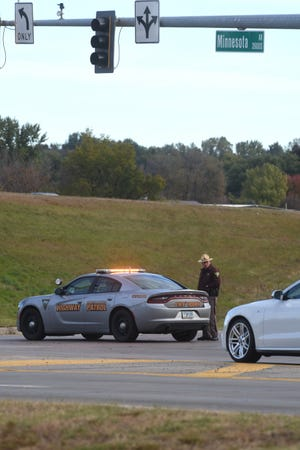 Highway patrol blocks the onramp of the northbound Interstate 229 at Minnesota Avenue after a crash on Tuesday, Oct. 16, 2018 in Sioux Falls, S.D.
