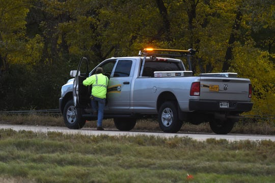 Department of Transportation removes the traffic cones off the northbound Interstate 229 at Minnesota Avenue after a crash on Tuesday, Oct. 16, 2018 in Sioux Falls, S.D.