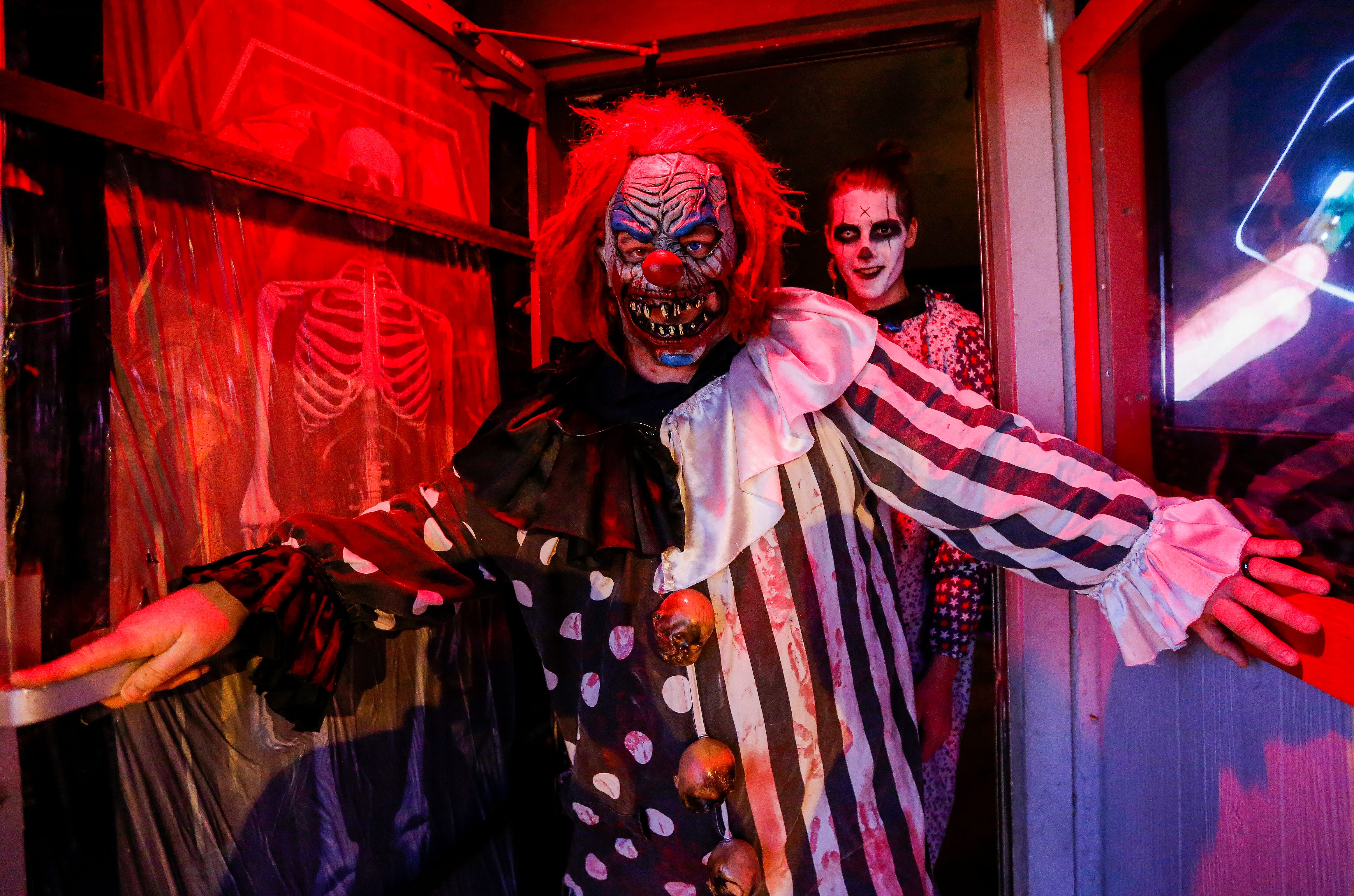 A pair of creepy clowns emerge from the entrance of the Hotel of Terror located at 334 N. Main St.