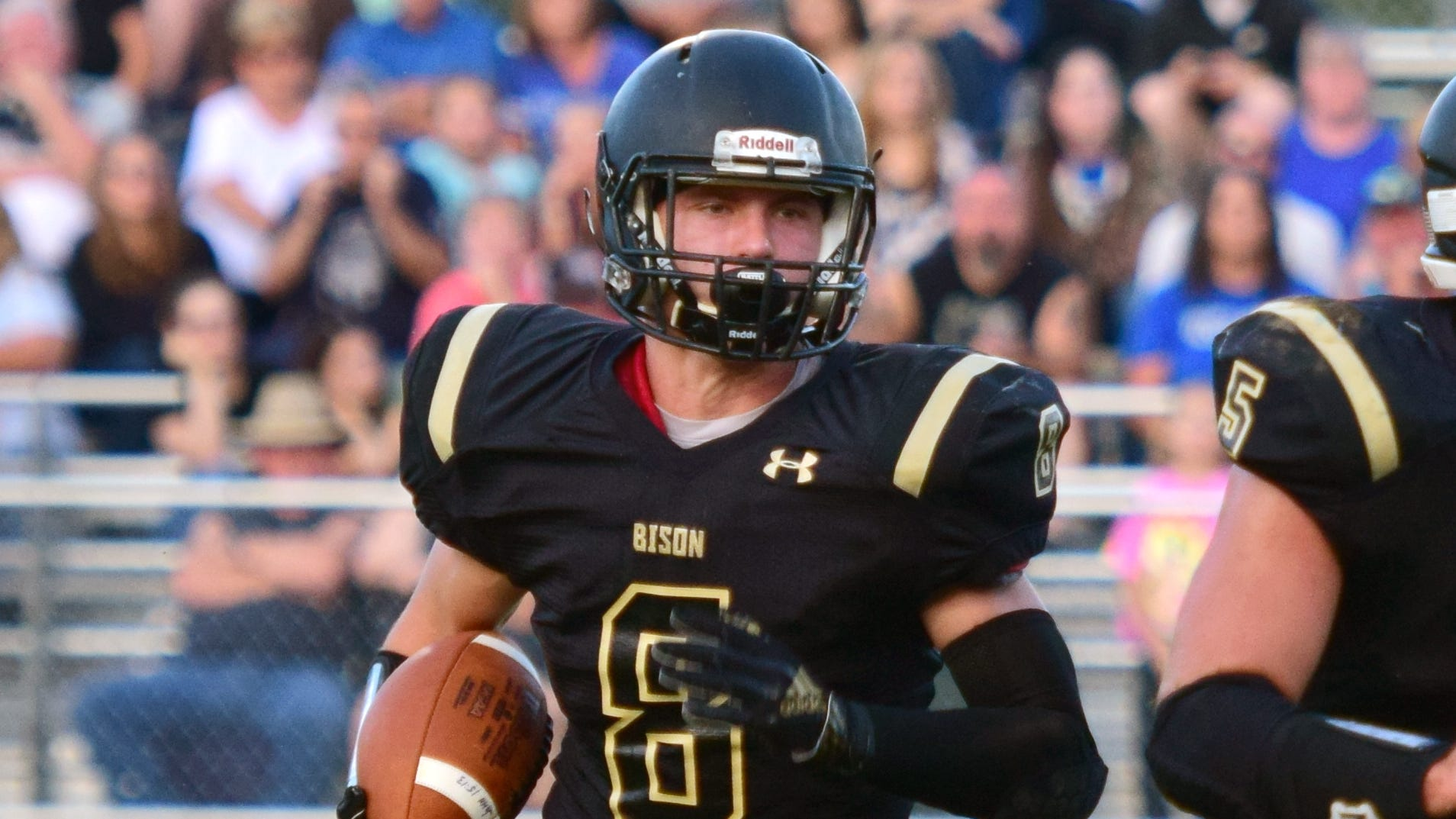 Buffalo Gap's Carter Rivenburg, left, was voted Huddle Player of the Week for the fourth time this season after his Week 8 performance against East Rockingham.