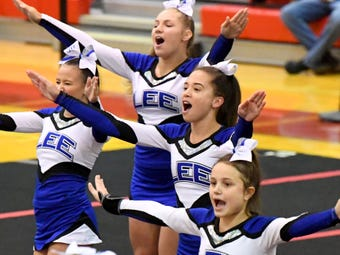 Coach Ginny Prickett and team members April Harper and Lexi St. Clair talk about the team's effort at the district Competition Cheer championships.