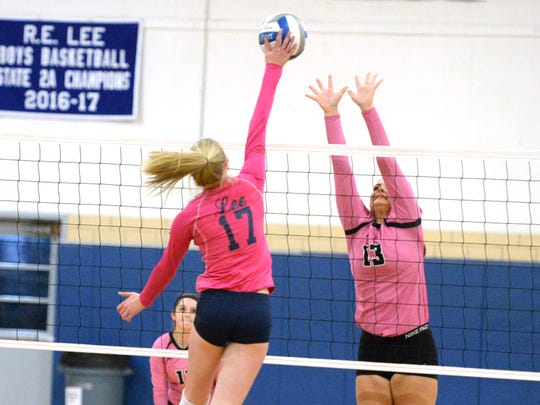 Stuarts Draft's Madie Varner (13) tries to block Lee High's Lillian Kopia Monday night in a Shenandoah District match.