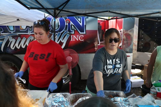 Jade Boyll, left and Hailey Moravek, Blountstown elementary school teachers, volunteer serving food with Dalton Trucking Inc. at the corner of Main Street North and Central Avenue West in Blountstown, Fla. in the aftermath of Hurricane Michael Thursday, Oct. 16, 2018.