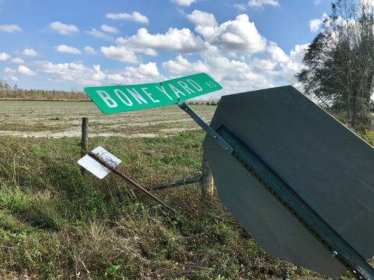 The hurricane-damaged sign for Boneyard Road in Sneads.