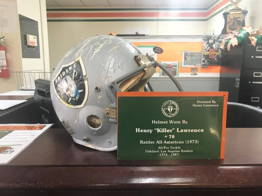 Henry Lawrence's helmet with the Oakland Raiders is on display inside FAMU's Galimore-Powell Field House. He is up for enshrinement in the Black College Football Hall of Fame.