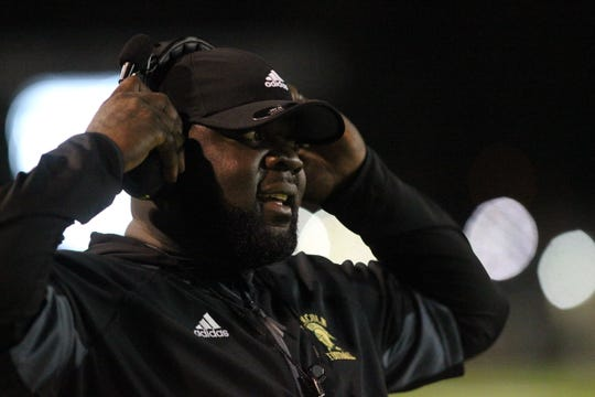 Lincoln coach Quinn Gray watches his team as the Lincoln Trojans played host to the Leon Lions at Gene Cox Stadium on Monday, Oct. 15, 2018. The Trojans won 56-21 to capture a District 2-7A title.