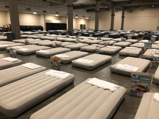 Air mattresses are laid out for linemen to sleep at the Civic Center.
