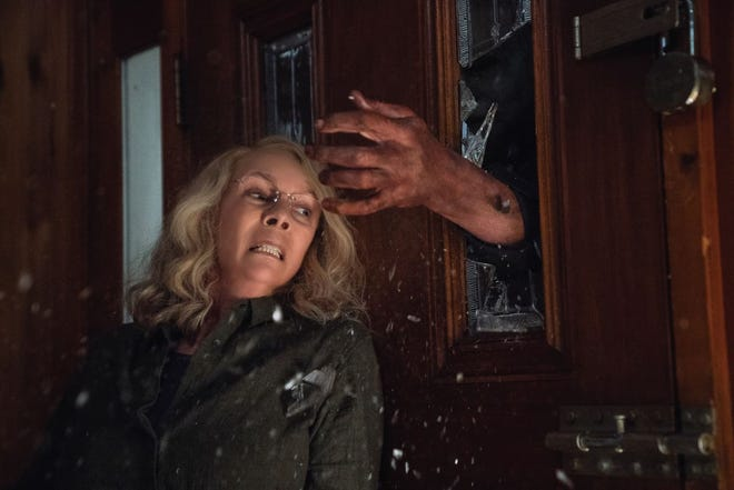 "Jamie Lee Curtis is back to do battle in ""Halloween"" (2108), opening Friday."