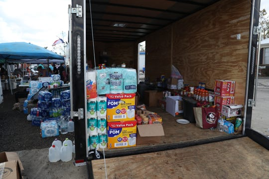 Dalton Trucking Inc. brings food, water and supplies to those in Blountstown, Fla. and Calhoun County in the aftermath of Hurricane Michael Tuesday, Oct. 16, 2018.
