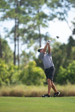 Chase Scholze, of Jensen Beach High School, tees off at the fifth hole of the Dunes course Tuesday, Oct. 16, 2018, during the boys golf District 22-2A tournament at Sandridge Golf Club in Vero Beach.