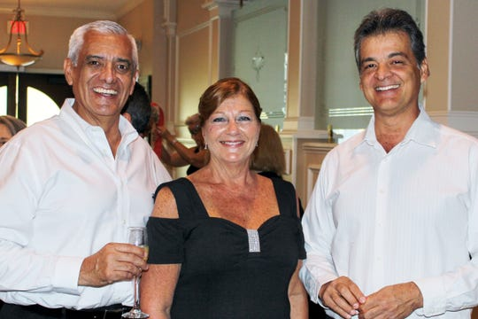 Francisco Alvarez, left, Joan Barcus and Rodolfo Villamizar represented Harlequin sponsor MBV Engineering Inc. at the Black & White Masquerade Ball at Vero Beach Country Club.