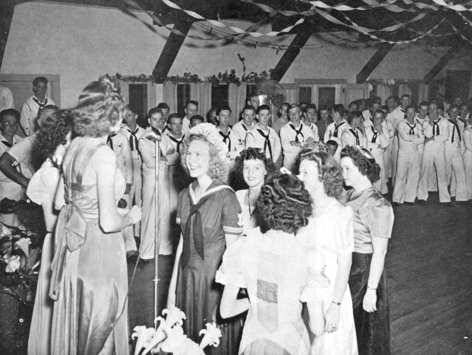 """Florida's Historic Indian River County,"" by Charlotte Lockwood, 1976. Community Center dance. Sailors waited for a chance to dance with the girls at this April 29, 1943 dance at the Community Center in Vero Beach."