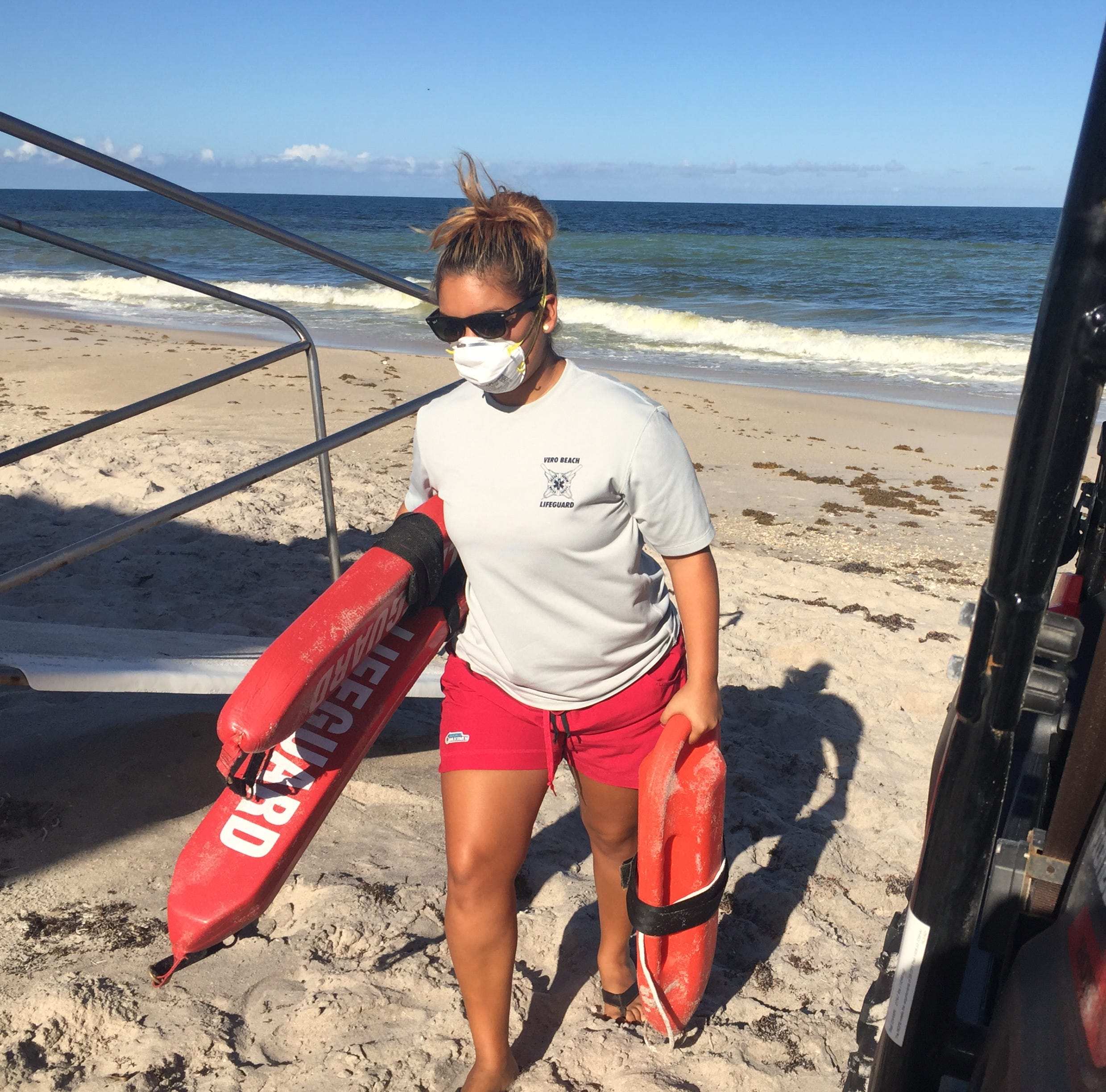 Red tide alert in Vero Beach: One man holds shirt to nose while joggers do their thing