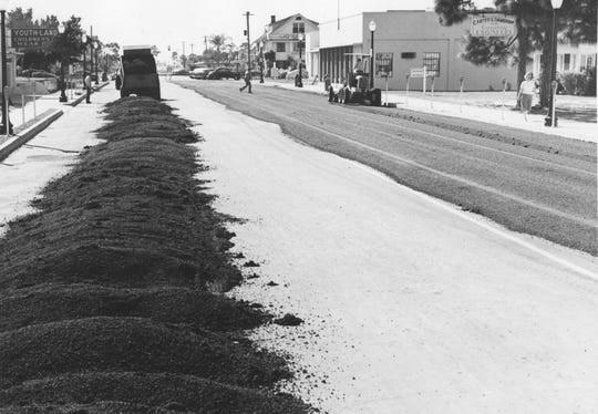 Auto travelers in the early part of the 1900s were largely confined to unpaved roads that weaved between settlements along the western shore of the Indian River. In this picture, the downtown area was getting new pavement.