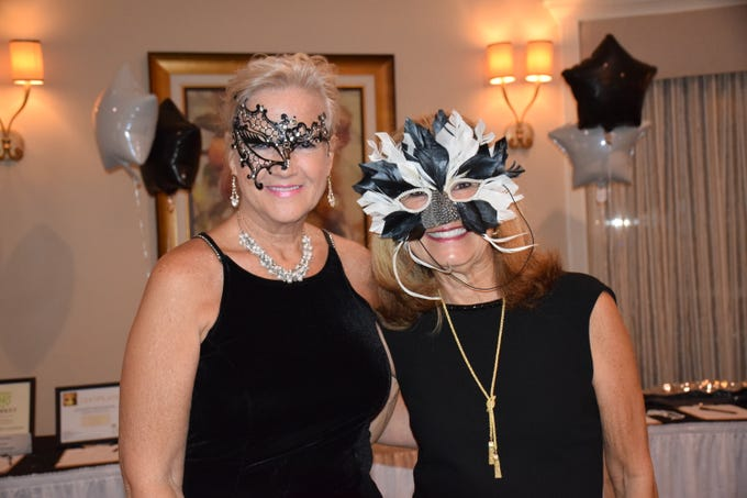 Donning masks are Sue Dempsey and Andrea Molloy.