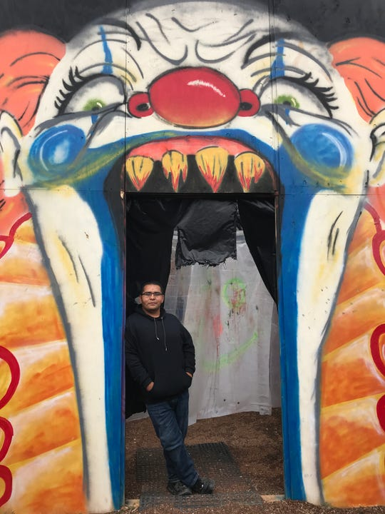 Mario Alvarado, whose family owns Desert Warriors Paintball, stands at the doorway of the Psycho Circus, one of several haunted houses on the property.