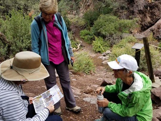 Soroptimist members Lynda Hayes, Joan Dormody and Jan Brydon taking a break while they study the La Flora Monument challenge.