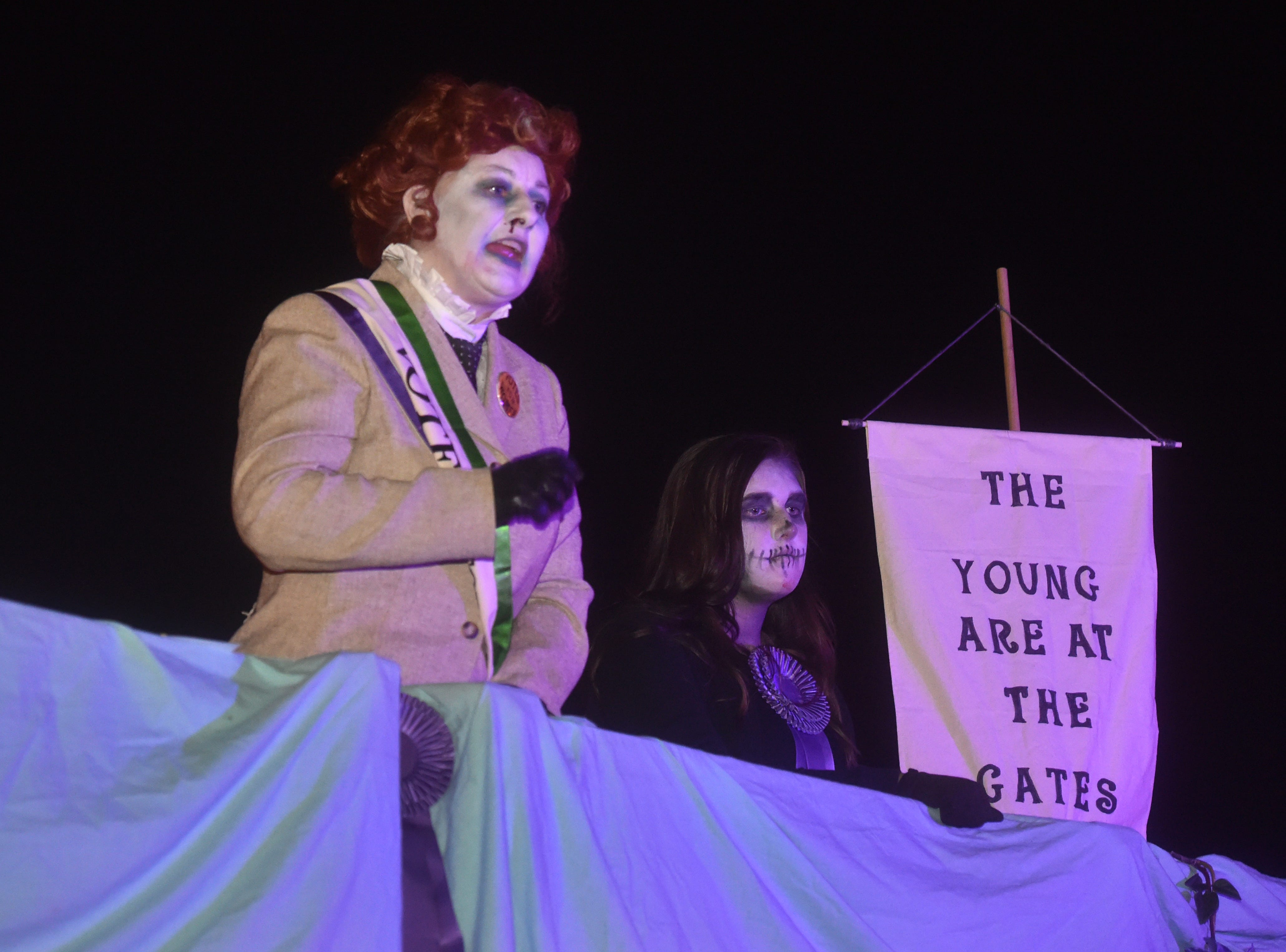 Collette Swan, left, of the Santa Paula Theater Center, plays the role of Rose Marshall in the fight for women's right to vote during the annual Ghostwalk  event at the historic Santa Paula Train Depot and Museum of Ventura County's Agriculture Museum.