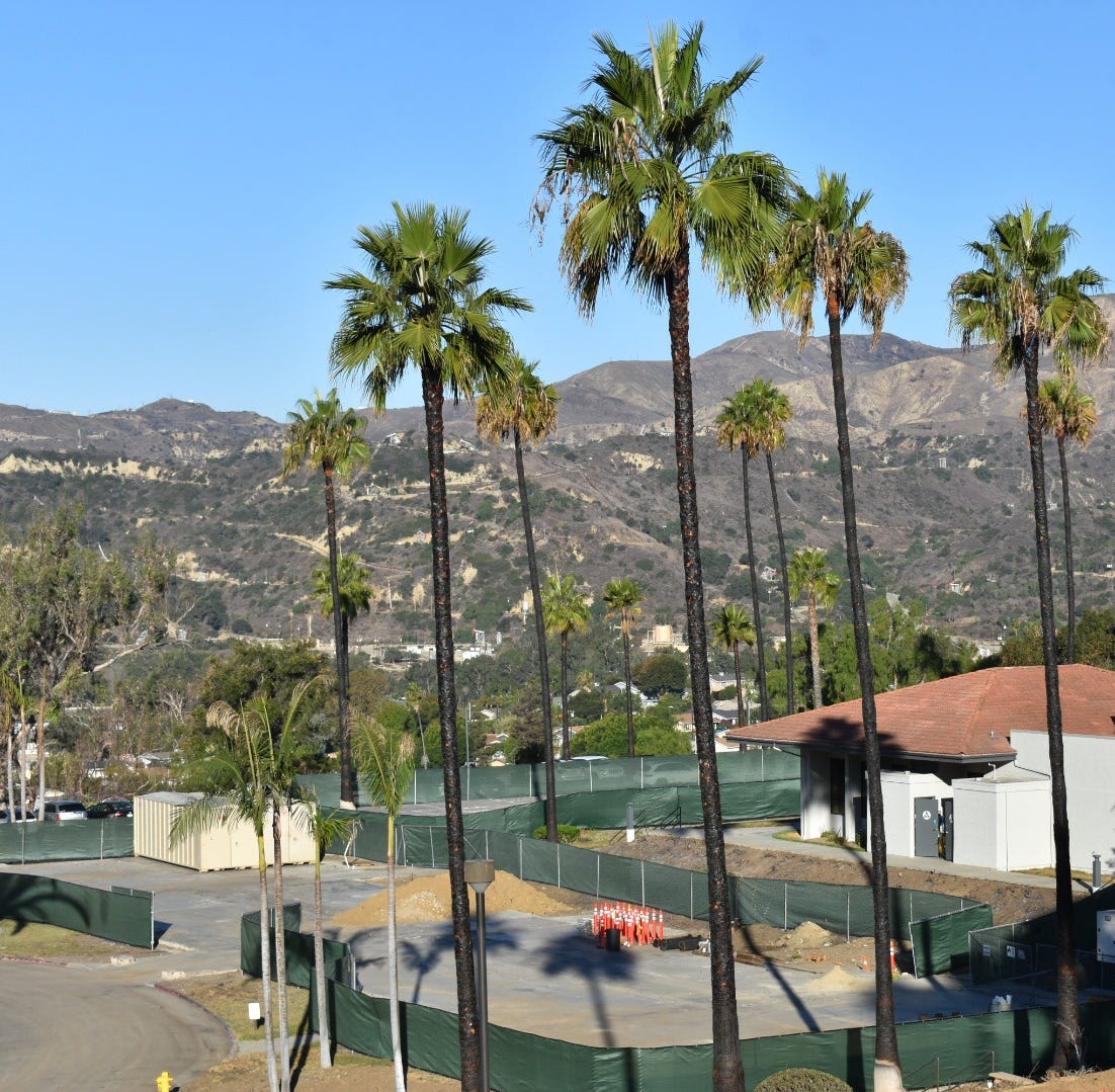 Surrounded by charred palm trees, Vista del Mar psychiatric hospital reopened 27 beds Tuesday morning, nearly 11 months after the Ventura facility was damaged in the massive Thomas Fire.