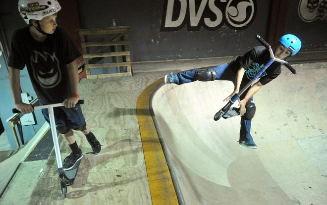 A couple of young skateboarders ply their skills at SkateLab in Simi Valley.
