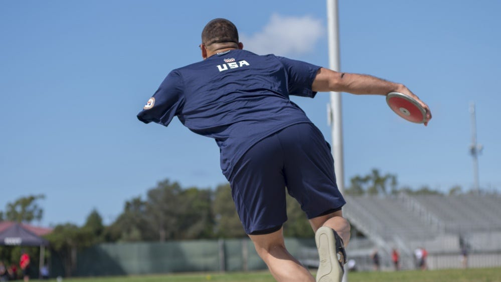 Retired U.S. Army Staff Sgt. Michael Kacer throws a discus during track and field practice at Oxnard College for the 2018 Invictus Games being held Oct. 20-27 in Sydney, Australia.