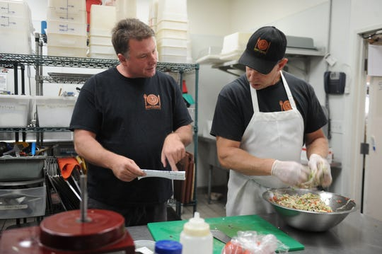 Robert Jacobi, left, founder and president of Main Course California, talks with executive chef Matt Hastings in the kitchen of the Ventura-based catering company. In addition to launching a pop-up restaurant this week, the company will participate in the Star's Wine & Food Experience Nov. 10 in Camarillo.