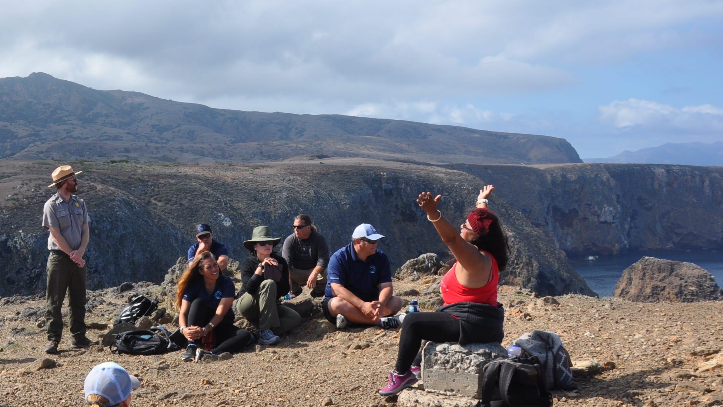 Local Chumash elders and crew members from the Hikianalia share stories on Santa Cruz Island.