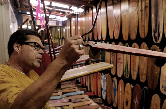 Todd Huber, co-founder of SkateLab in Simi Valley, shown in 2012 in the facility's museum which included hundreds of older model skateboards.