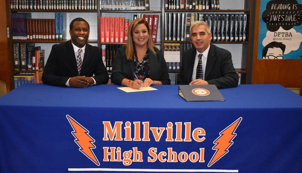 (From left) Jerome Taylor from the Carver Institute, Stephanie DeRose, principal, Millville High School, and James Piccone, vice president, Cumberland County College, formalize an agreement which will allow Millville High School students to earn a college degree while attending high school.