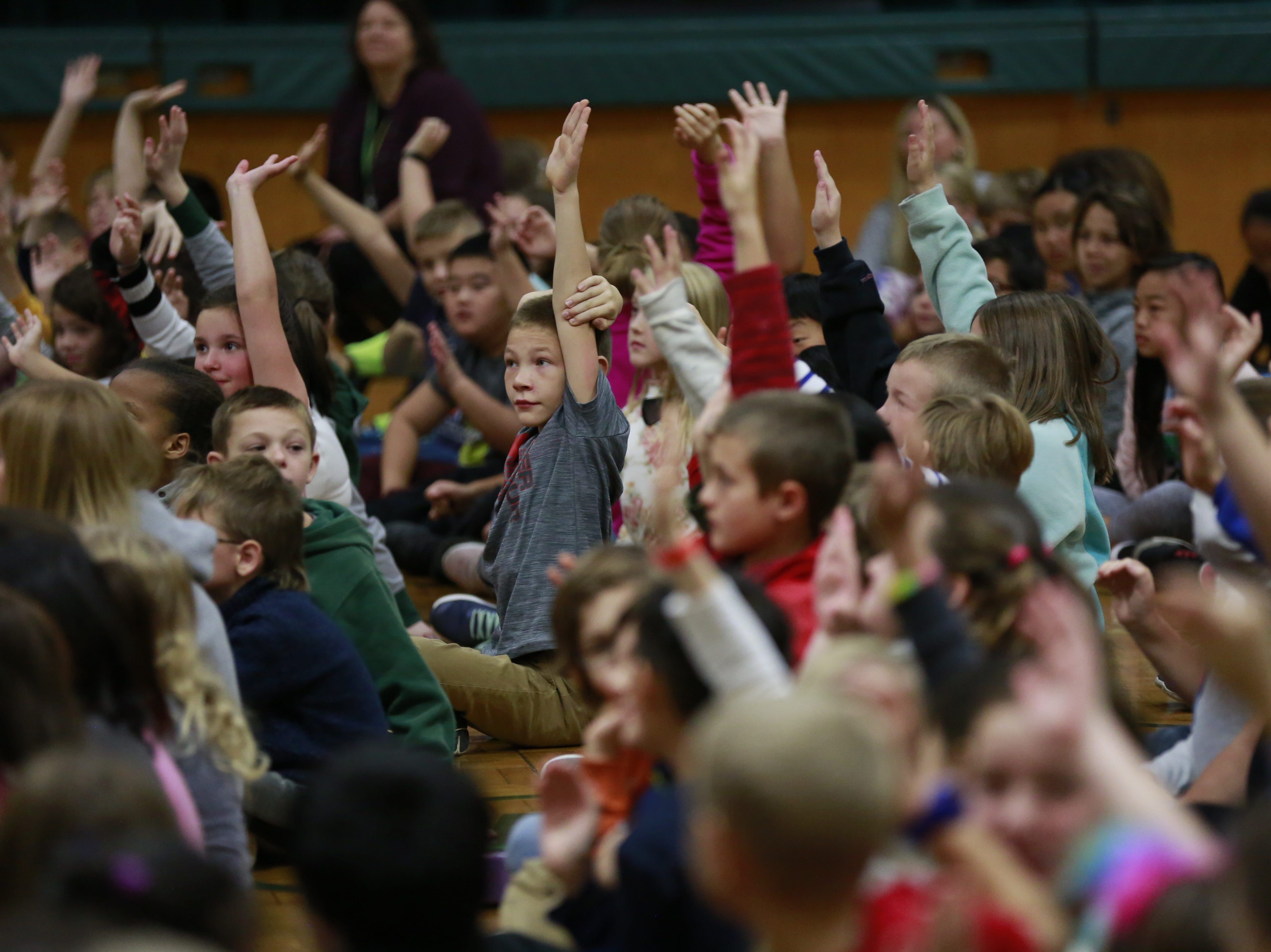 Students raise their hands to be called by former MSU basketball player Anthony Ianni on Monday, Oct. 15, 2018, during the Anti-Bullying Relentless Tour to Visit Wisconsin at Weston Elementary School in Weston, Wis.