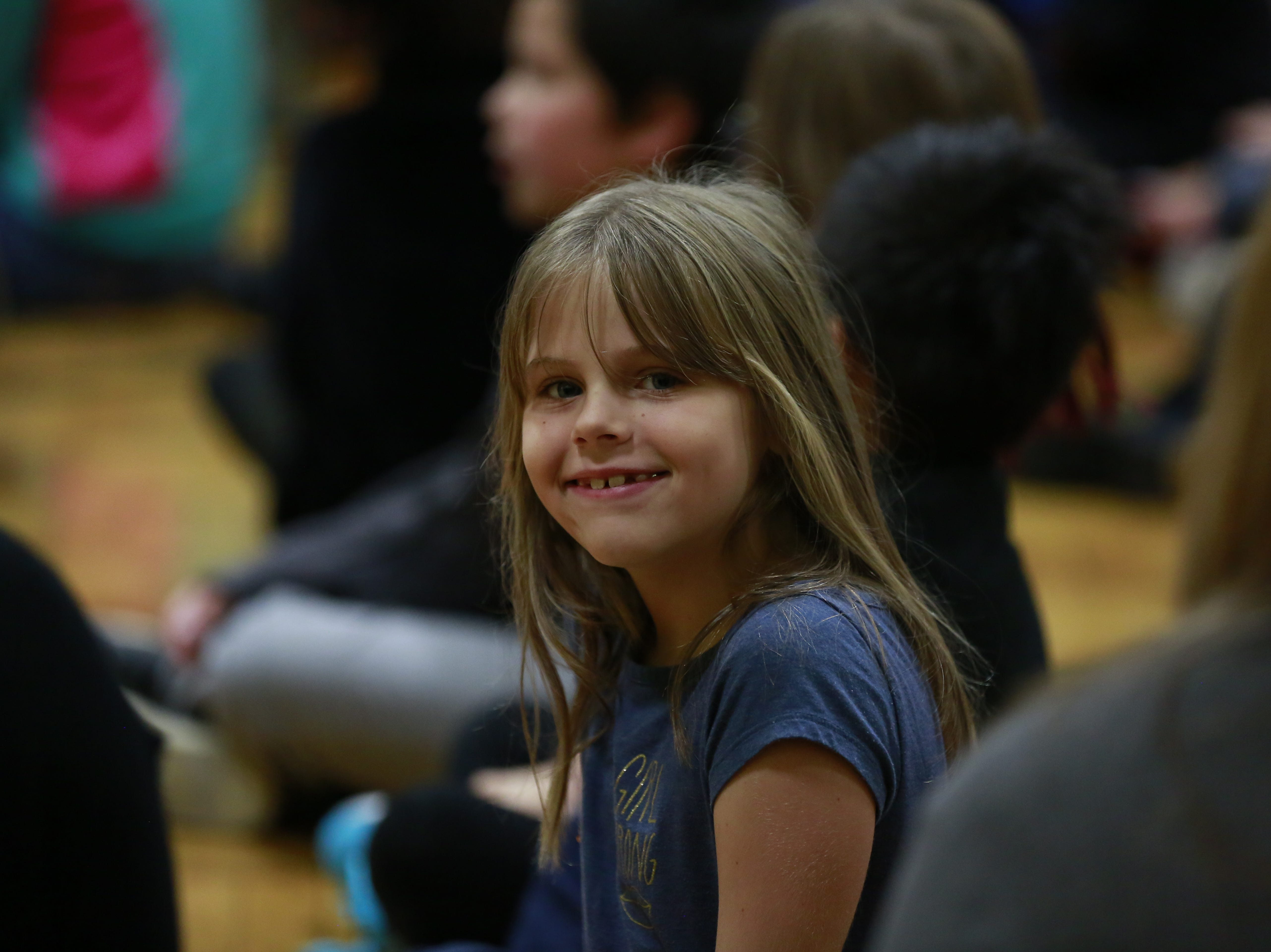 A student smiles at the camera Monday, Oct. 15, 2018, during the Anti-Bullying Relentless Tour to Visit Wisconsin at Weston Elementary School in Weston, Wis. T'xer Zhon Kha/USA TODAY NETWORK-Wisconsin