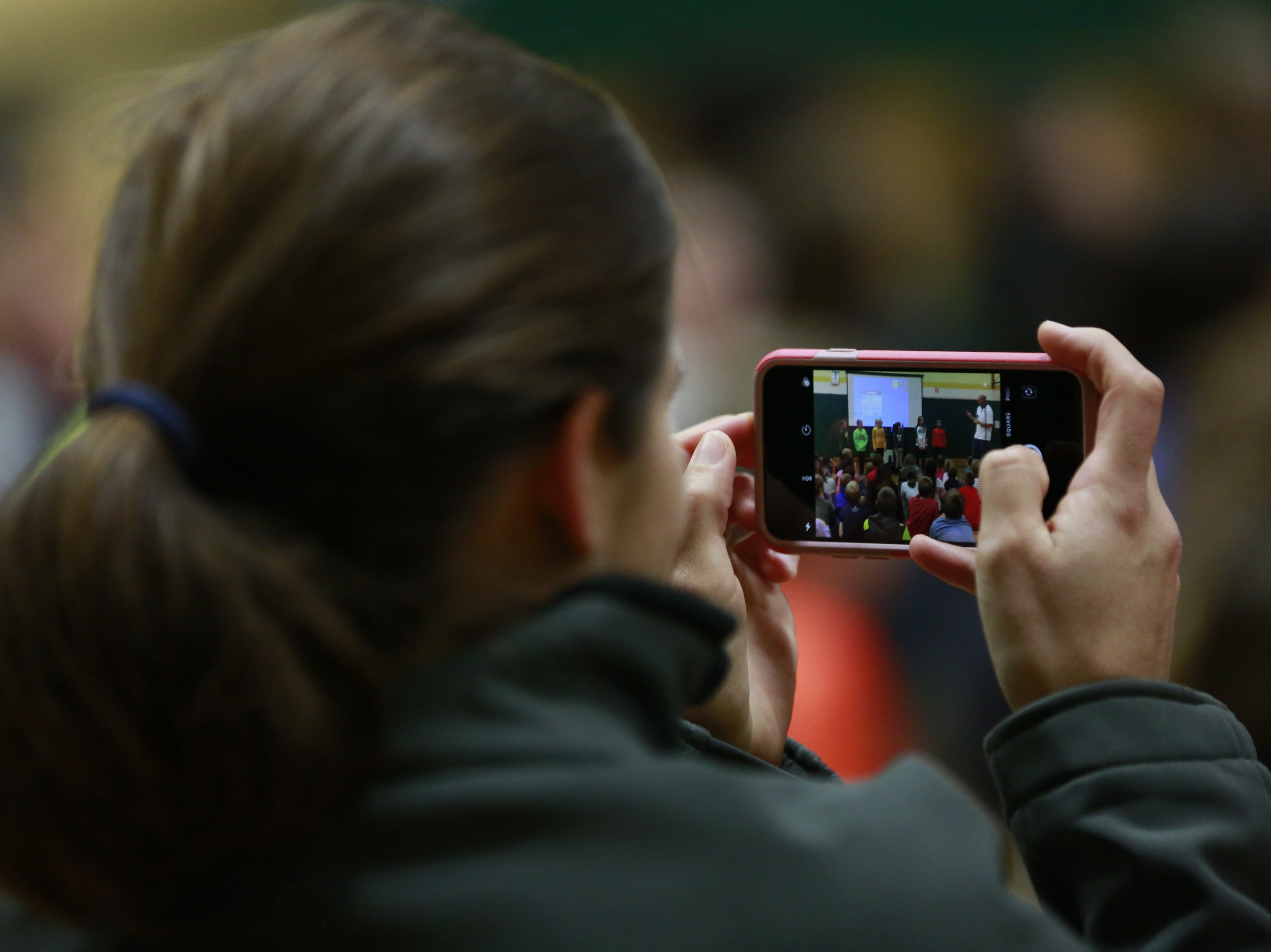 A teacher takes iPhone photo of students Monday, Oct. 15, 2018, during the Anti-Bullying Relentless Tour to Visit Wisconsin at Weston Elementary School in Weston, Wis. T'xer Zhon Kha/USA TODAY NETWORK-Wisconsin