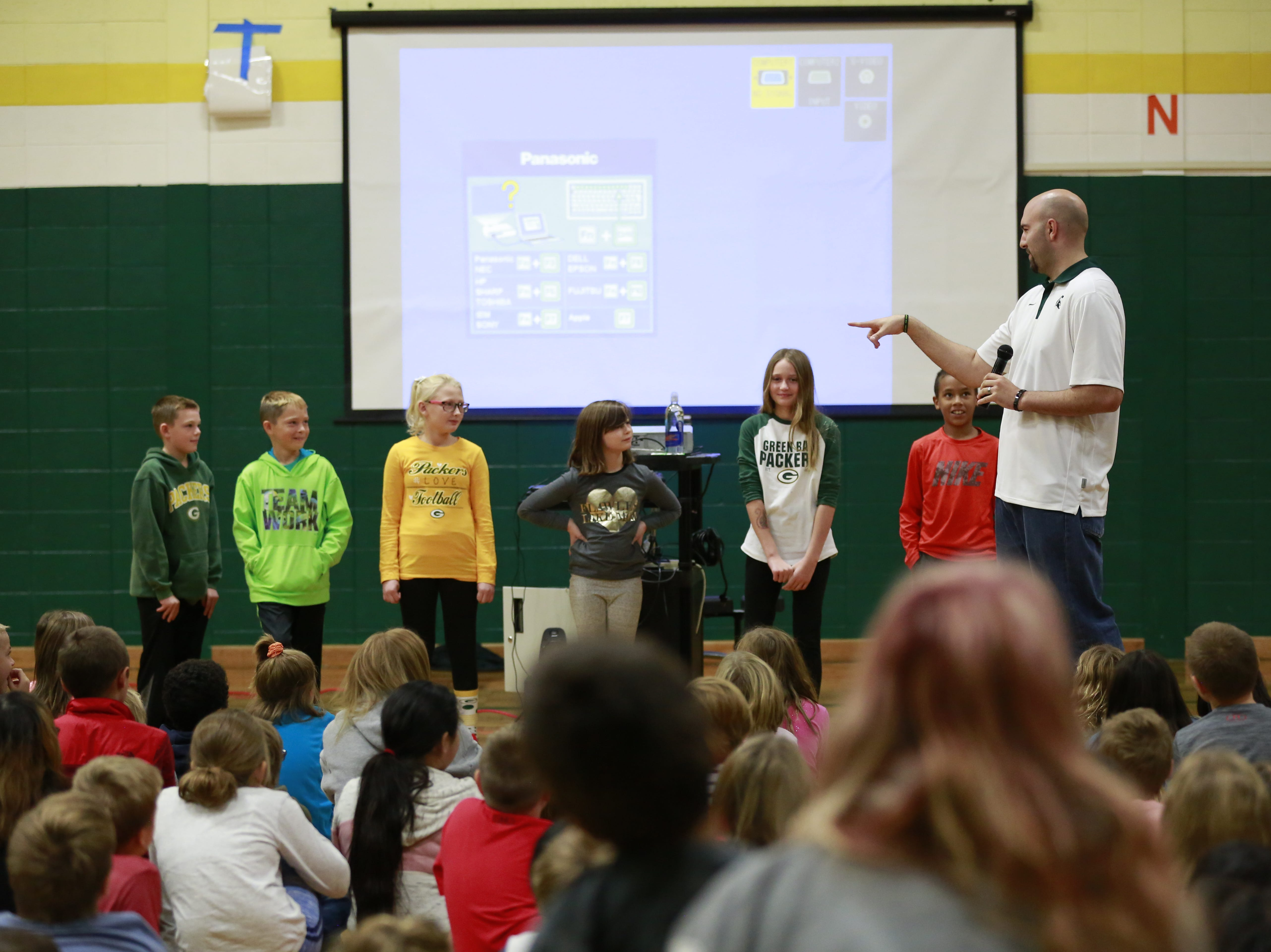Former MSU basketball player Anthony Ianni lines up students for an activity Monday, Oct. 15, 2018, as part of the Anti-Bullying Relentless Tour to Visit Wisconsin at Weston Elementary School in Weston, Wis.