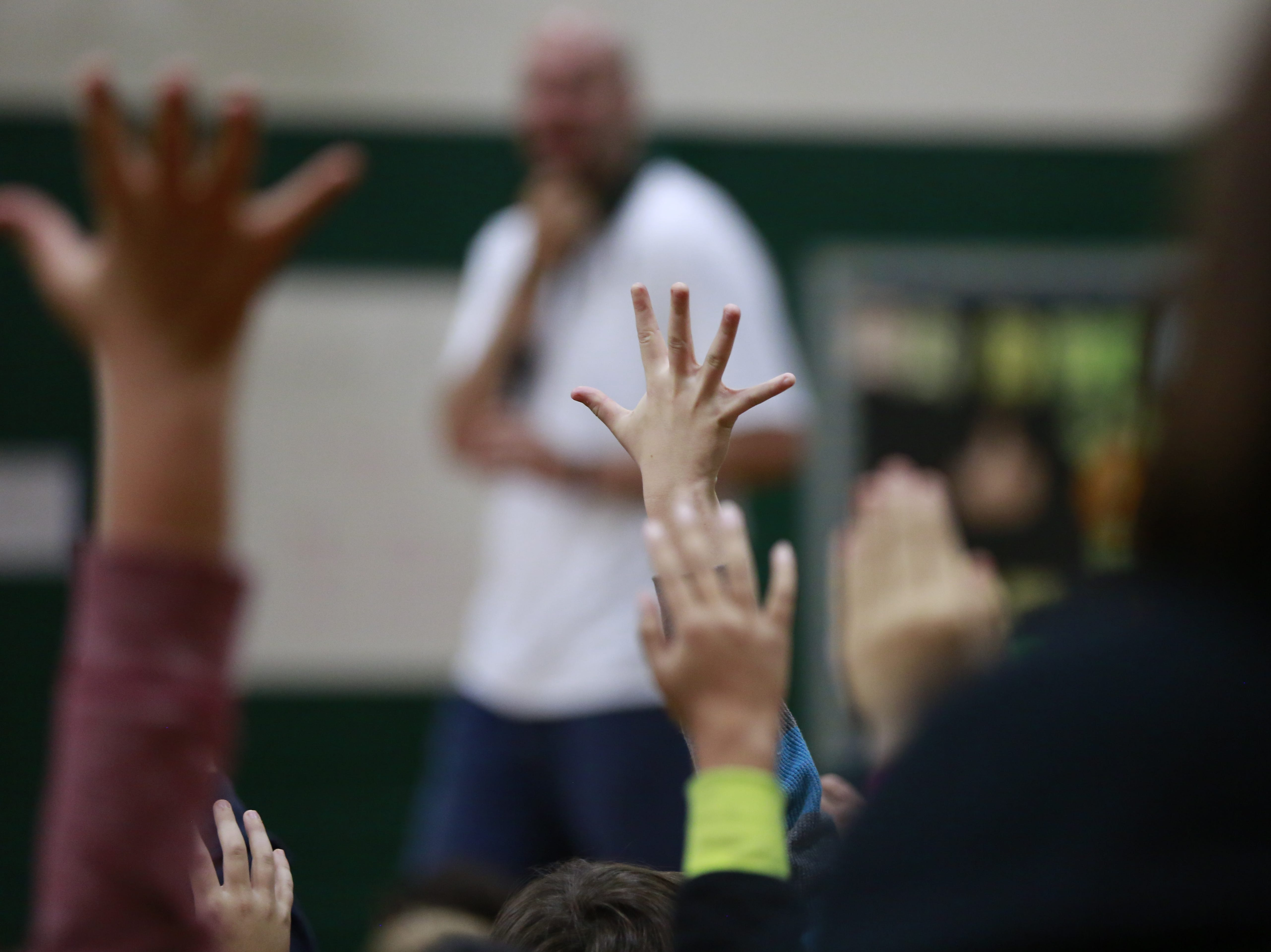 Hands raise by students Monday, Oct. 15, 2018, during the Anti-Bullying Relentless Tour to Visit Wisconsin at Weston Elementary School in Weston, Wis. T'xer Zhon Kha/USA TODAY NETWORK-Wisconsin