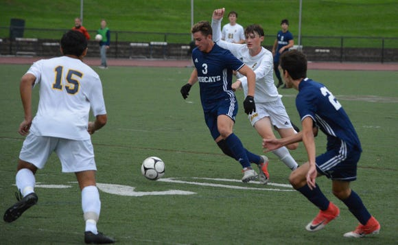 Byram Hills defender Michael Kalian gets to the ball first and changes the direction of play Monday against Pelham.